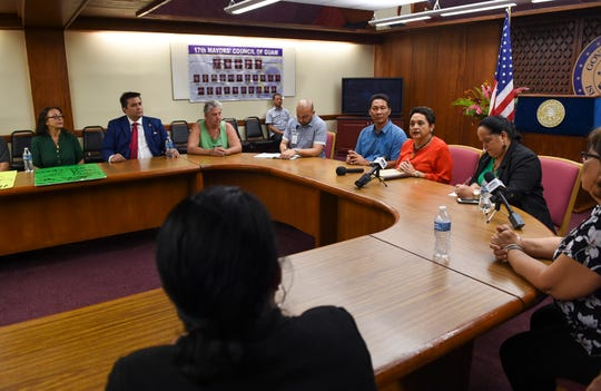 Pro-recreational marijuana supporters meet with Gov. Lou Leon Guerrero, third from right, at the Ricardo J. Bordallo Governor's Complex in Adelup, March 29, 2019.
