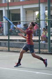 Camden Camacho follows through on a forehand in Men's singles action at last weekend's 47th Annual Chamorro Open, held at the Rick Ninete Tennis Center and Ypao Gardens Condominiums. The tournament continues for the next three weekends.