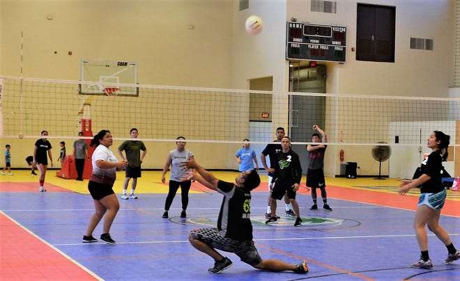 Action from last year's championship game between DNA Dizzy and the Bank of Guam Yankees at the inaugural Volley for Cause.