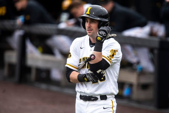 Iowa's Chris Whelan (28) walks out to the plate during a NCAA Big Ten Conference baseball game on Friday, March 29, 2019, at Duane Banks Field in Iowa City, Iowa.