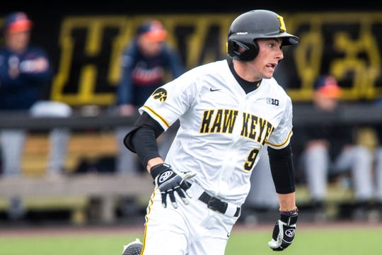 Iowa outfielder Ben Norman (9) rounds first during a NCAA Big Ten Conference baseball game on Friday, March 29, 2019, at Duane Banks Field in Iowa City, Iowa.
