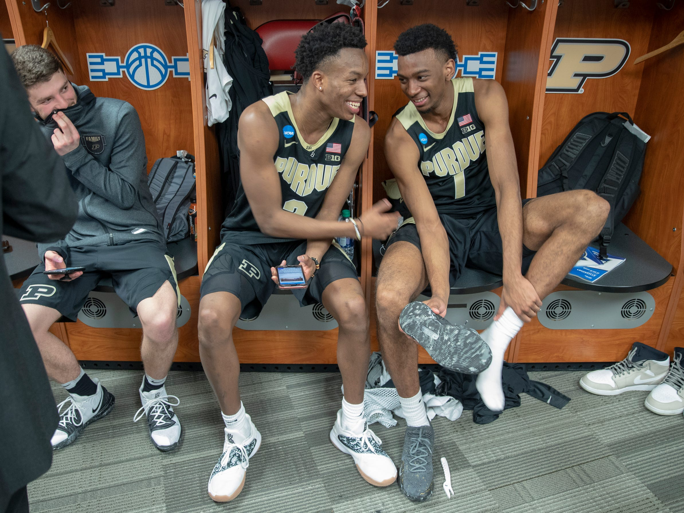 Eric Hunter Jr. of the Purdue Boilermakers (middle), smiles with Aaron Wheeler in the locker room after their victory over Tennessee, NCAA Division 1 Men's Basketball 'Sweet Sixteen' game, KFC Yum Center, Louisville, Thursday, March 28, 2019. Purdue won 99-94.