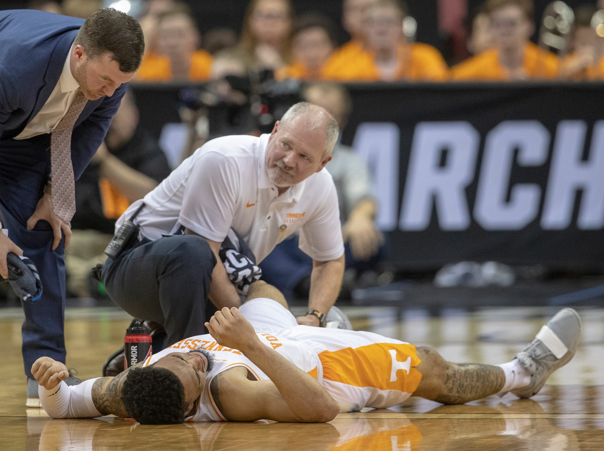 Lamonte Turner of the Tennessee Volunteers is tended to after an injury sidelined him momentarily during the game with Purdue, NCAA Division 1 Men's Basketball 'Sweet Sixteen' game, KFC Yum Center, Louisville, Thursday, March 28, 2019. Purdue beat Tennessee 99-94.
