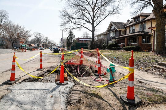 Construction cones sit around a sewer grate along College Ave. in Indianapolis where construction crews are building infrastructure for the Red Line bus route on Thursday, March 28, 2019. The Red Line will run from Broad Ripple to downtown Indianapolis, to the University of Indianapolis and more.