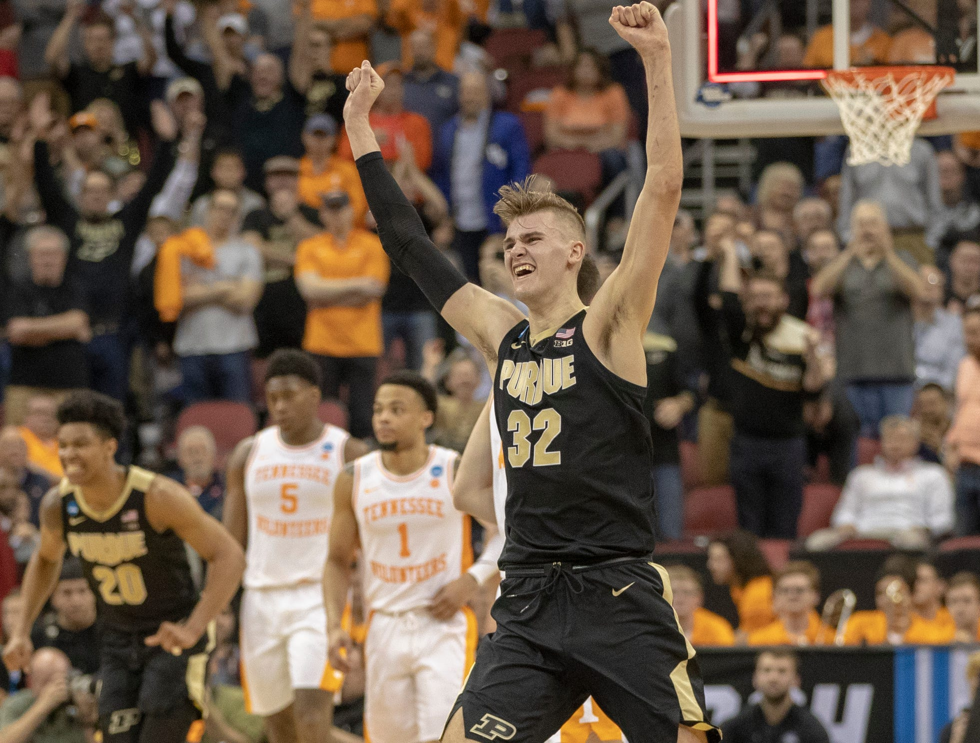 Matt Haarms of the Purdue Boilermakers cheers after their victory over Tennessee, NCAA Division 1 Men's Basketball 'Sweet Sixteen' game, KFC Yum Center, Louisville, Thursday, March 28, 2019. Purdue beat Tennessee 99-94.