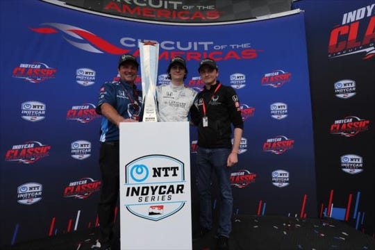 Harding Steinbrenner Racing team owners Mike Harding (left) and George Michael Steinbrenner IV (right) celebrate with their driver, Colton Herta, after he won the inaugural IndyCar Classic on March 24 at Circuit of the Americas