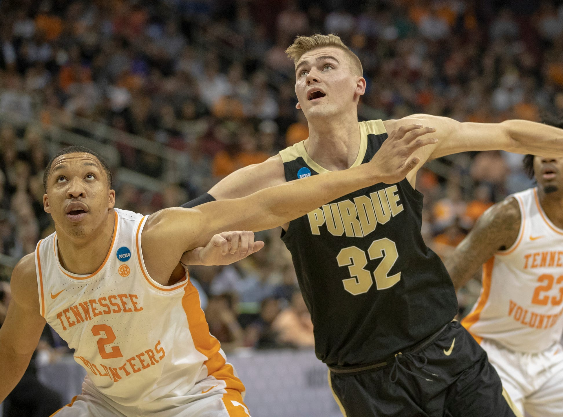 Grant Williams of the Tennessee Volunteers and Matt Haarms of the Purdue Boilermakers hunt for a rebound, NCAA Division 1 Men's Basketball 'Sweet Sixteen' game, KFC Yum Center, Louisville, Thursday, March 28, 2019.