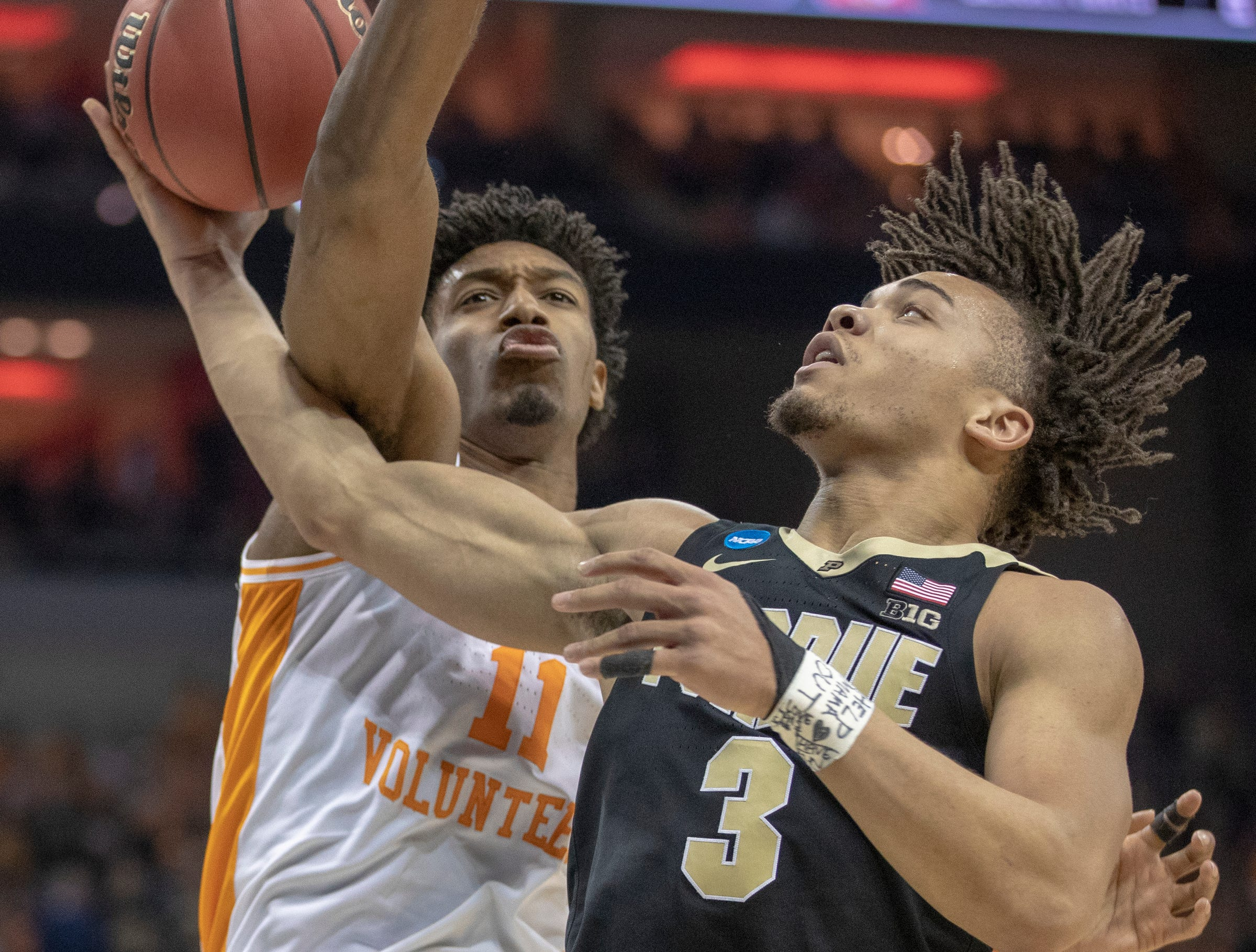 Carsen Edwards of the Purdue Boilermakers tries to loop a shot around defense by Kyle Alexander of the Tennessee Volunteers, NCAA Division 1 Men's Basketball 'Sweet Sixteen' game, KFC Yum Center, Louisville, Thursday, March 28, 2019. Purdue beat Tennessee 99-94.