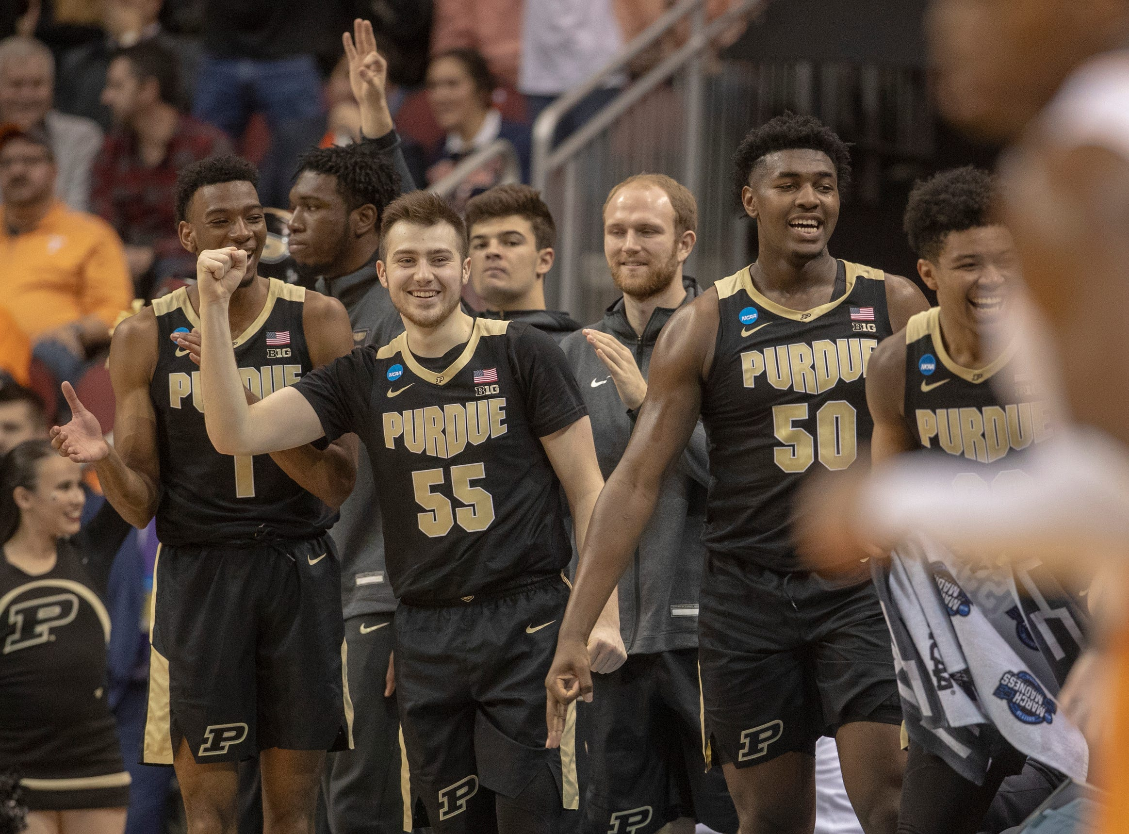 Purdue bench members cheer for a good shooting first half against Tennessee, NCAA Division 1 Men's Basketball 'Sweet Sixteen' game, KFC Yum Center, Louisville, Thursday, March 28, 2019.