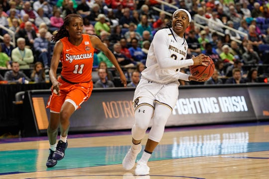 Arike Ogunbowale, right, is two wins away from a return trip to the Final Four and four away from making Notre Dame (32-3) the first non-UConn repeat champion in the women's game since Tennessee in 2007 and 2008.