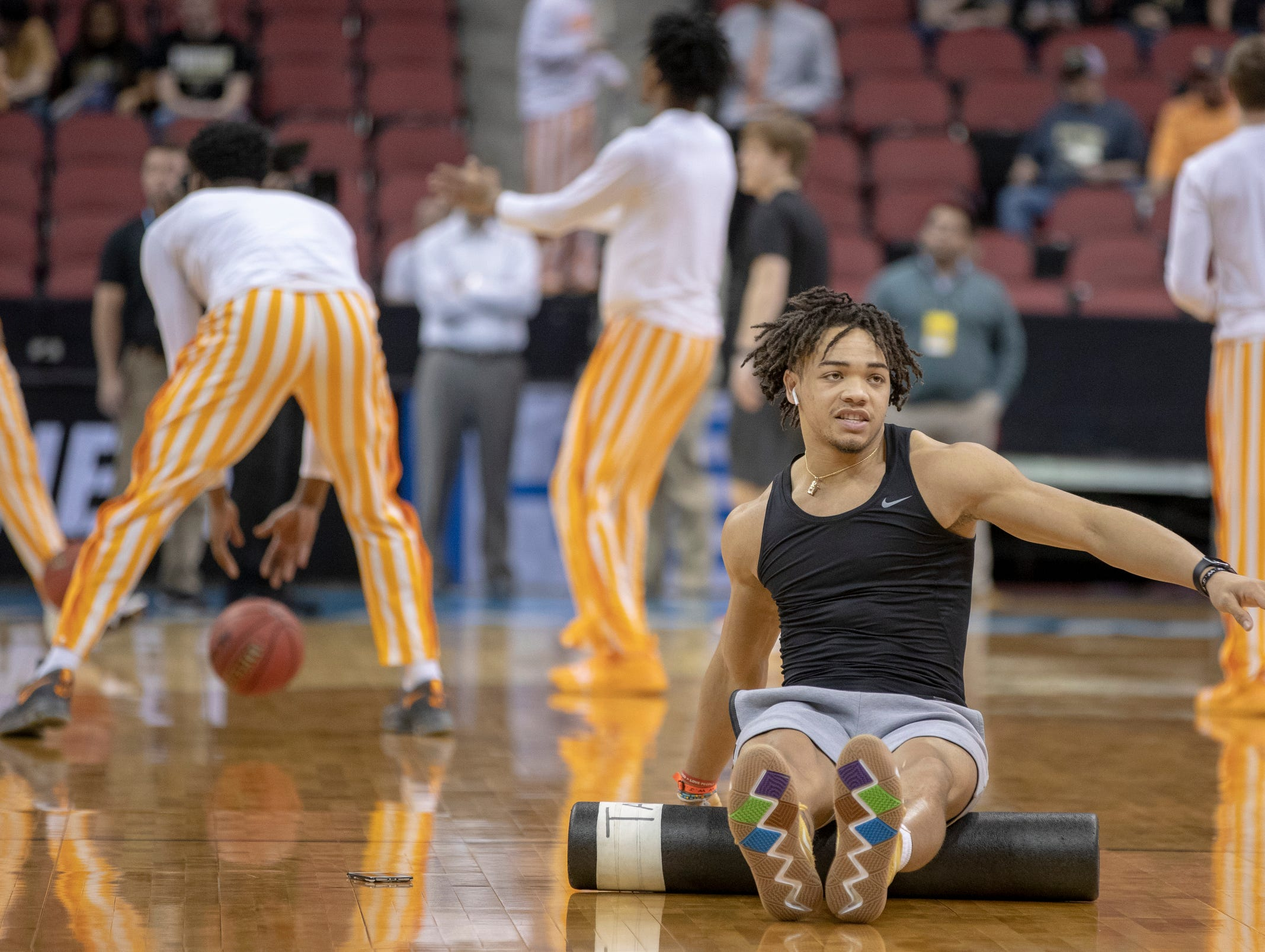Carsen Edwards, All-American guard for Purdue, gets some stretching in during warmups, NCAA Division 1 Men's Basketball 'Sweet Sixteen' game, KFC Yum Center, Louisville, Thursday, March 28, 2019.