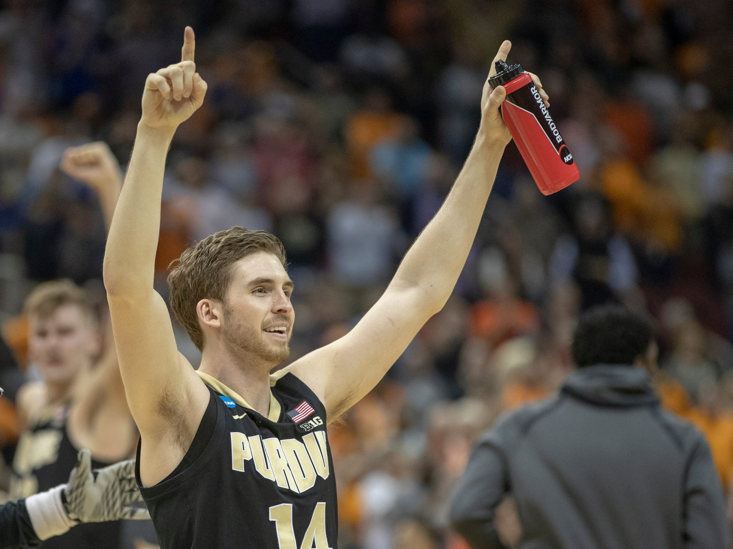 Ryan Cline of the Purdue Boilermakers cheers after their victory over Tennessee, NCAA Division 1 Men's Basketball 'Sweet Sixteen' game, KFC Yum Center, Louisville, Thursday, March 28, 2019. Purdue beat Tennessee 99-94.