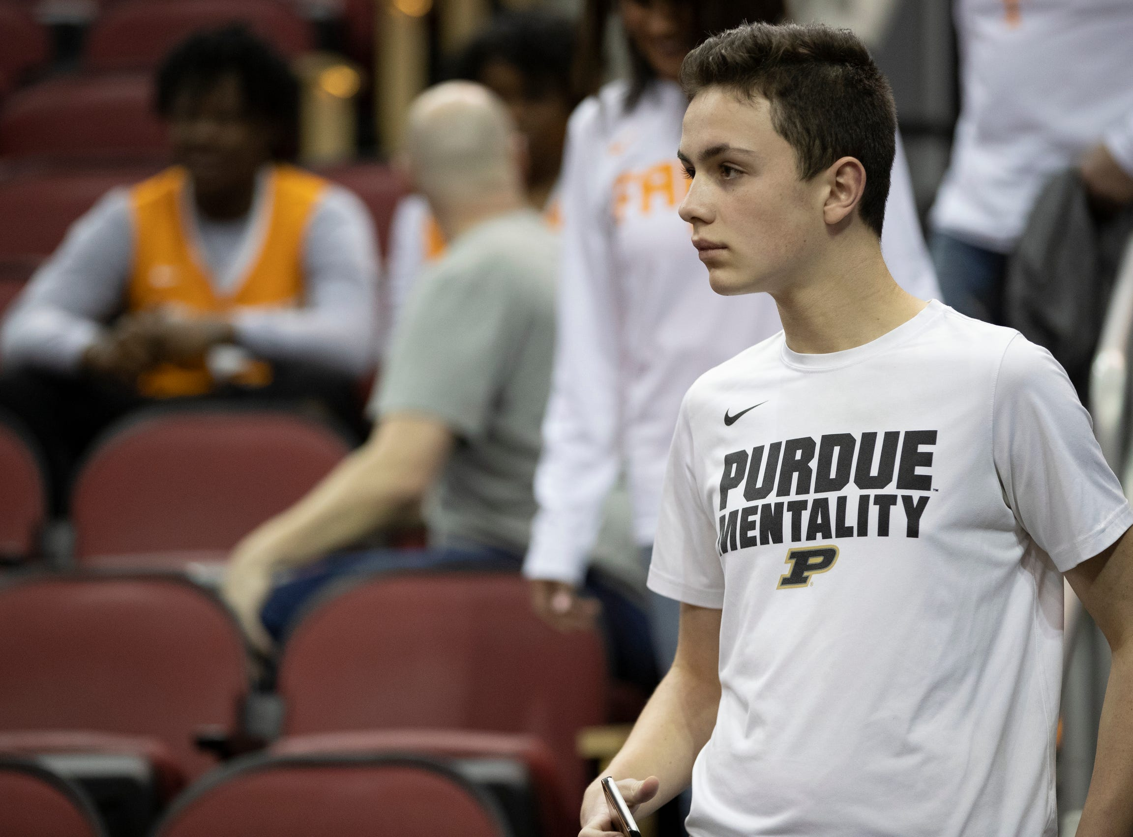 "Leyton Greeley, 15, Louisville, watches his team of choice warm up, pregame, NCAA Division 1 Men's Basketball 'Sweet Sixteen' game, KFC Yum Center, Louisville, Thursday, March 28, 2019. ""I sure hope they win,"" Greeley said."