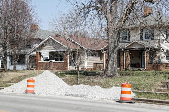 Construction materials are laid out down College Ave. in Indianapolis as construction crews build infrastructure for the Red Line bus route on Thursday, March 28, 2019. The Red Line will run from Broad Ripple to downtown Indianapolis, to the University of Indianapolis and more.