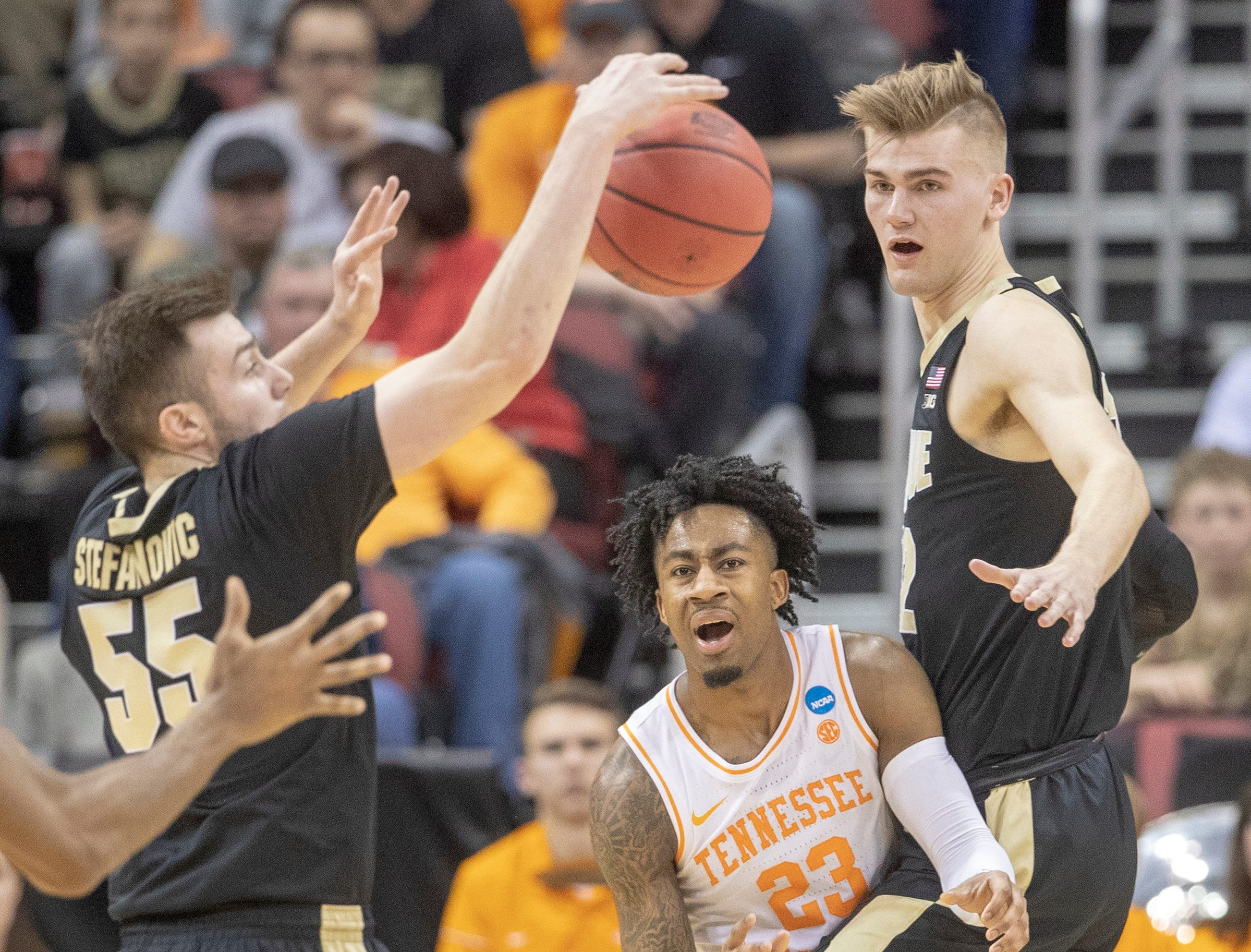 Jordan Bowden of the Tennessee Volunteers looks in despair as his pass was intercepted by Sasha Stefanovic of the Purdue Boilermakers, as Matt Haarms of the Purdue Boilermakers watches, NCAA Division 1 Men's Basketball 'Sweet Sixteen' game, KFC Yum Center, Louisville, Thursday, March 28, 2019. Purdue beat Tennessee 99-94.