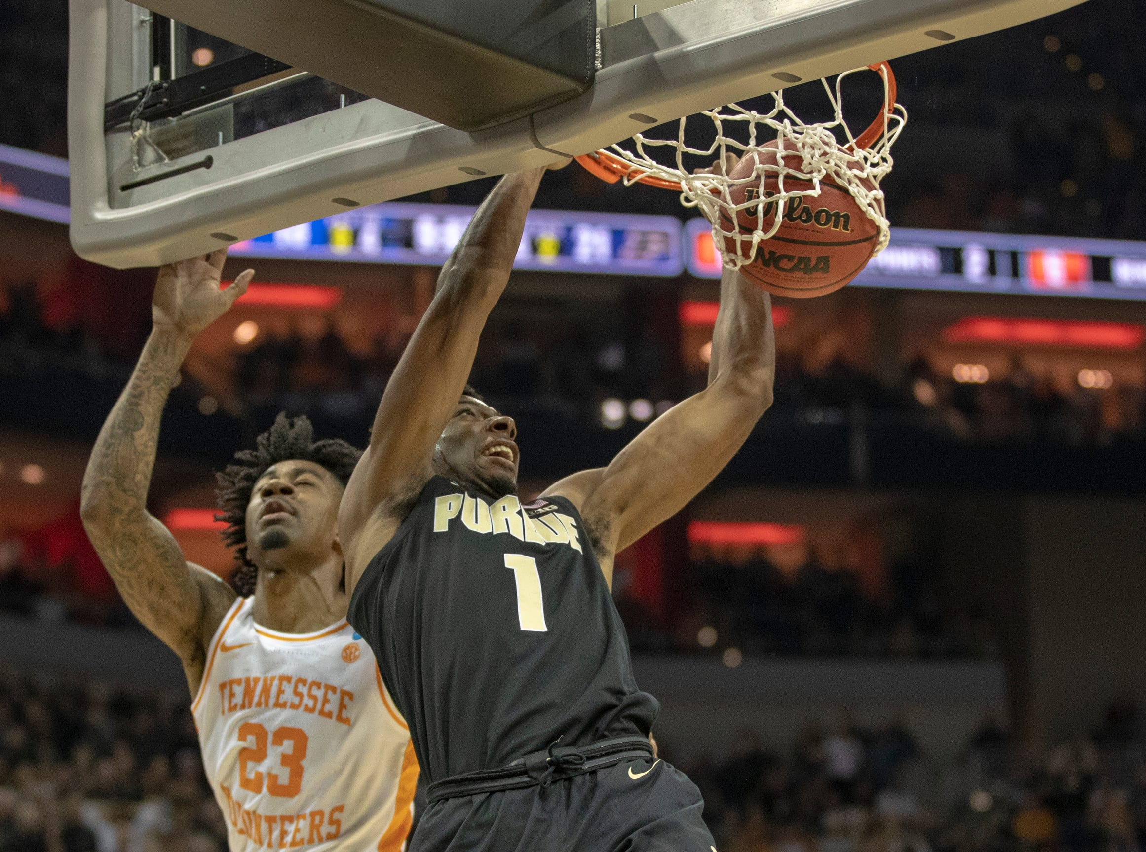 Aaron Wheeler of the Purdue Boilermakers dunks on Jordan Bowden of the Tennessee Volunteers during first half action, NCAA Division 1 Men's Basketball 'Sweet Sixteen' game, KFC Yum Center, Louisville, Thursday, March 28, 2019.