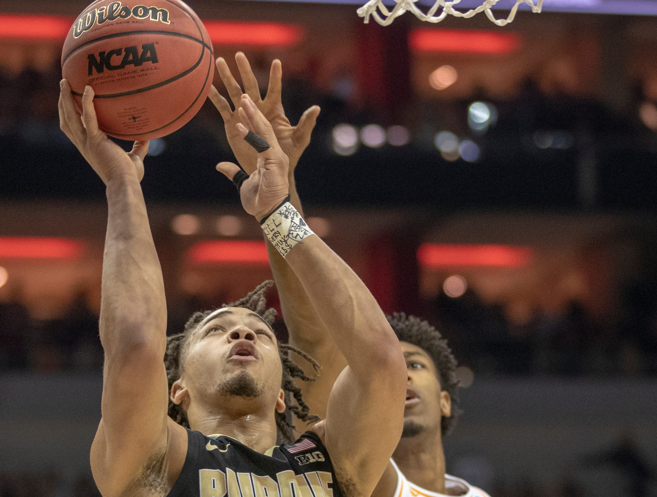 Carsen Edwards of the Purdue Boilermakers puts up a shot on Kyle Alexander of the Tennessee Volunteers, first half, NCAA Division 1 Men's Basketball 'Sweet Sixteen' game, KFC Yum Center, Louisville, Thursday, March 28, 2019.