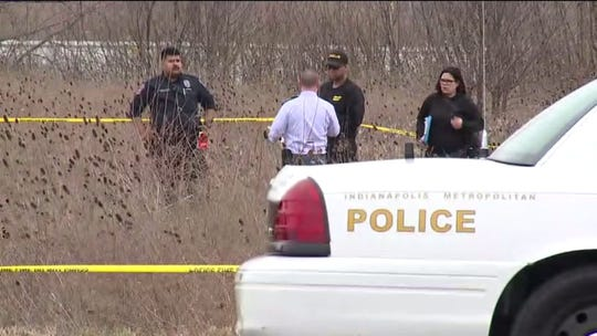 Indianapolis police investigate after a male body was found in a small creek area in the 5300 block of Pike Plaza Road.
