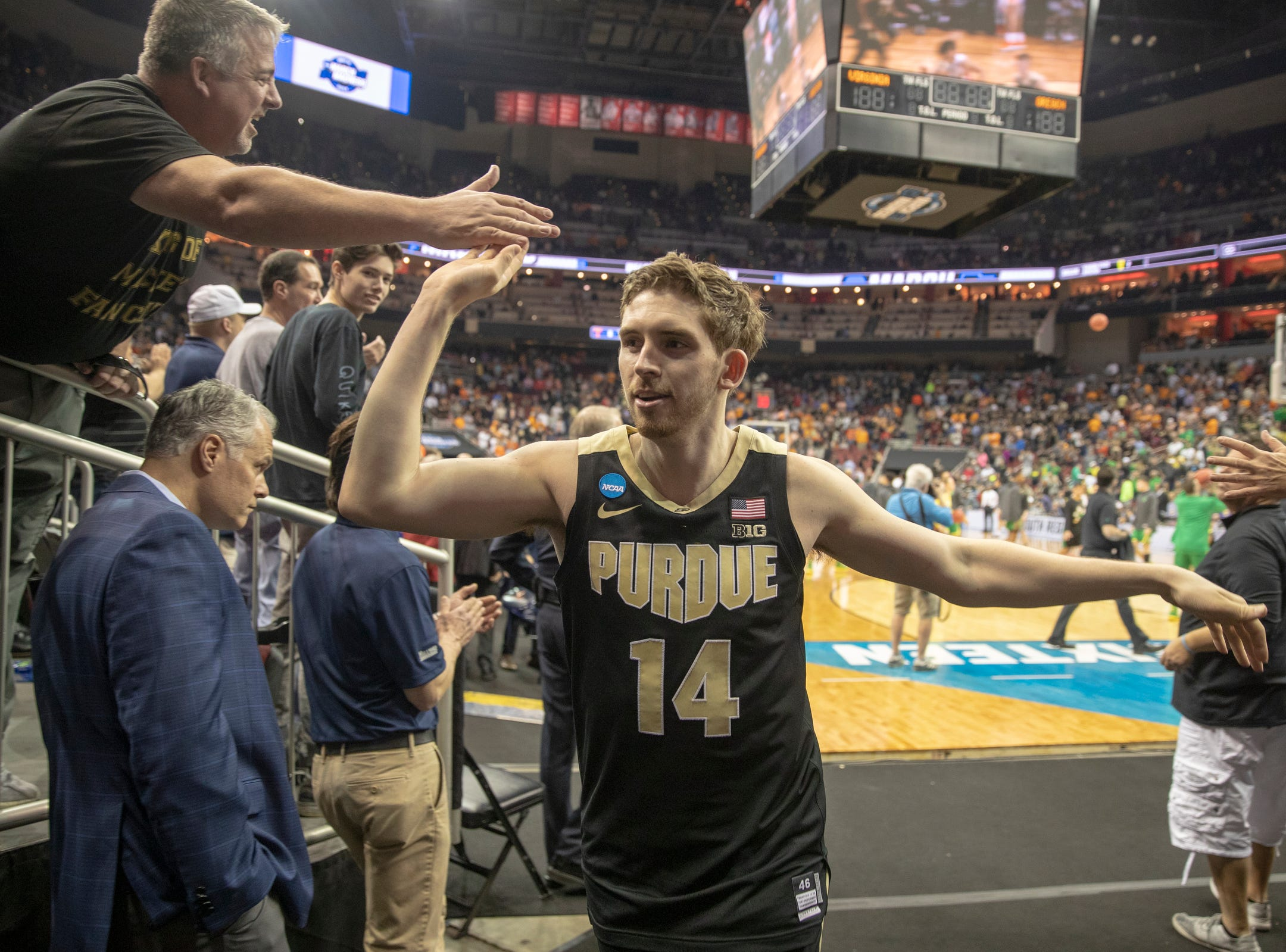 Ryan Cline of the Purdue Boilermakers slaps hands with fans after their win over Tennessee, NCAA Division 1 Men's Basketball 'Sweet Sixteen' game, KFC Yum Center, Louisville, Thursday, March 28, 2019. Purdue beat Tennessee 99-94.