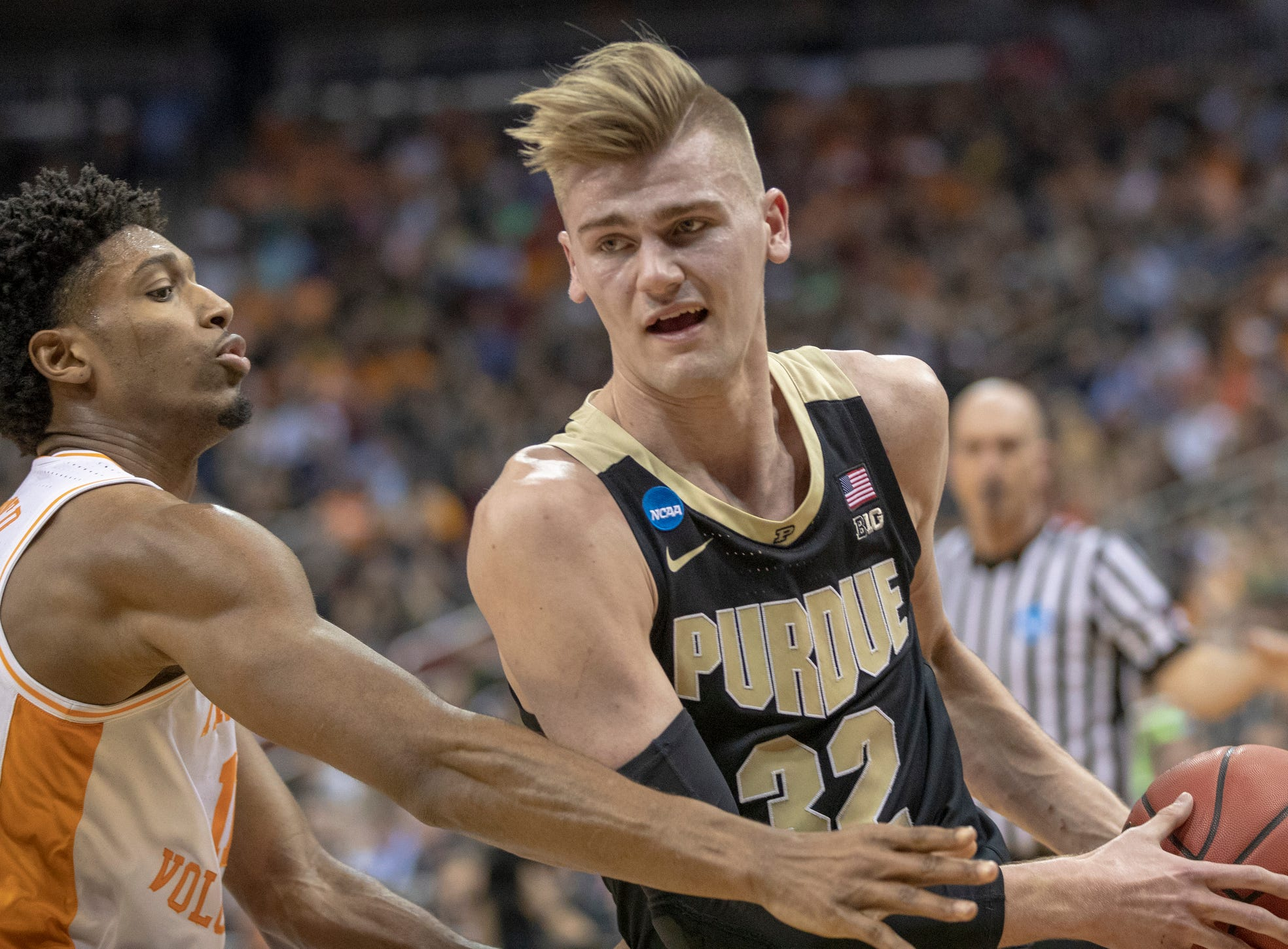 Kyle Alexander of the Tennessee Volunteers defends Matt Haarms of the Purdue Boilermakers, NCAA Division 1 Men's Basketball 'Sweet Sixteen' game, KFC Yum Center, Louisville, Thursday, March 28, 2019. Purdue beat Tennessee 99-94.