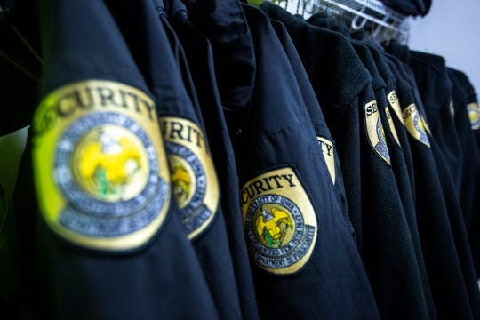 University of Iowa Department of Public Safety security jackets hang in the equipment room, March 29, 2019, at the University of Iowa Police headquarters in Iowa City, Iowa.