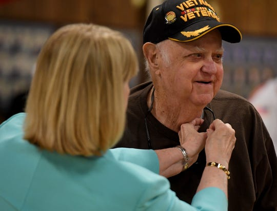 Jackson-Madison Chapter National Society Daughters of the American Revolution Honorary Regent Jackie Utley resents Vietnam Veteran Thomas Grimsley with a pin during the commemoration of the 50th anniversary of the Vietnam War, Friday, March 29, 2019 at VFW Post 6496.