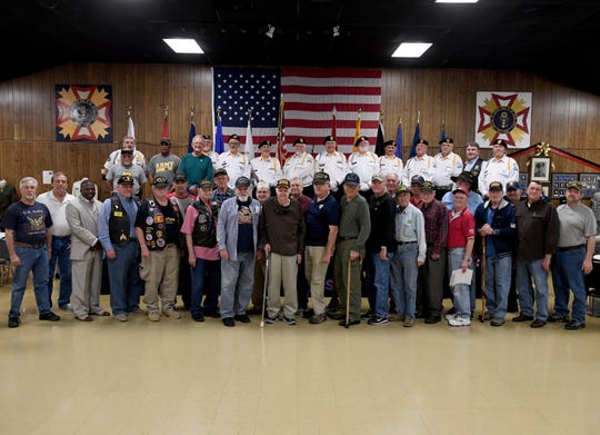 Vietnam Veterans gather for a photo at the end of the commemoration of the 50th anniversary of the Vietnam War, Friday, March 29, 2019 at VFW Post 6496.