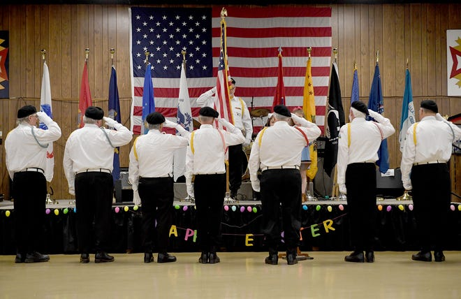 Vietnam Veterans of America Chapter 995 Honor Guard salute the American Flag at the start of the commemoration of the 50th anniversary of the Vietnam War, Friday, March 29, 2019 at VFW Post 6496.