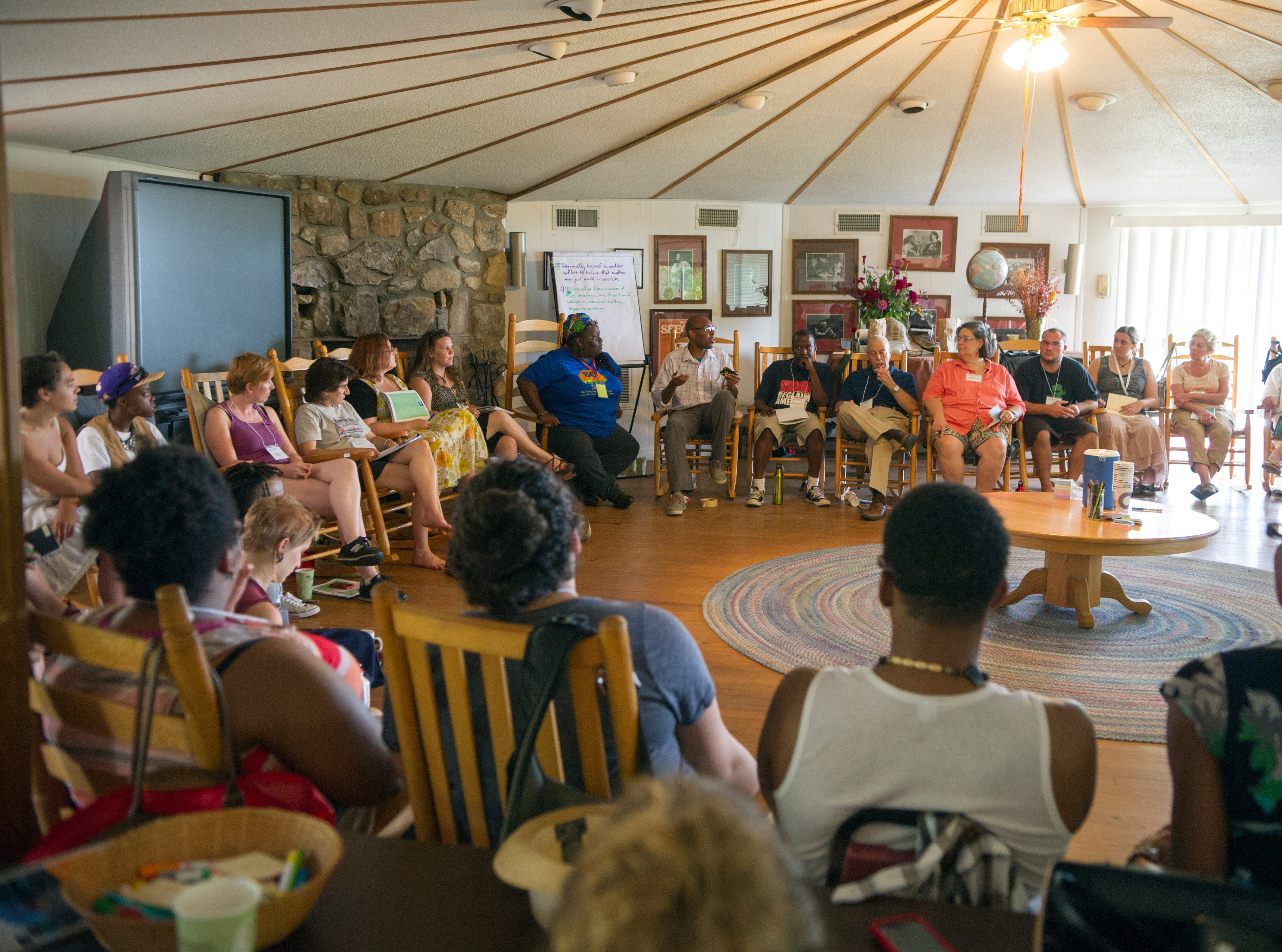 Attendees gather in the upper workshop center for a session on cultural organizing led by Marquez Rhyne and Tufara Waller Muhammad during the 80th anniversary celebration at the Highlander Research and Education Center in New Market Saturday, Sept. 1, 2012.