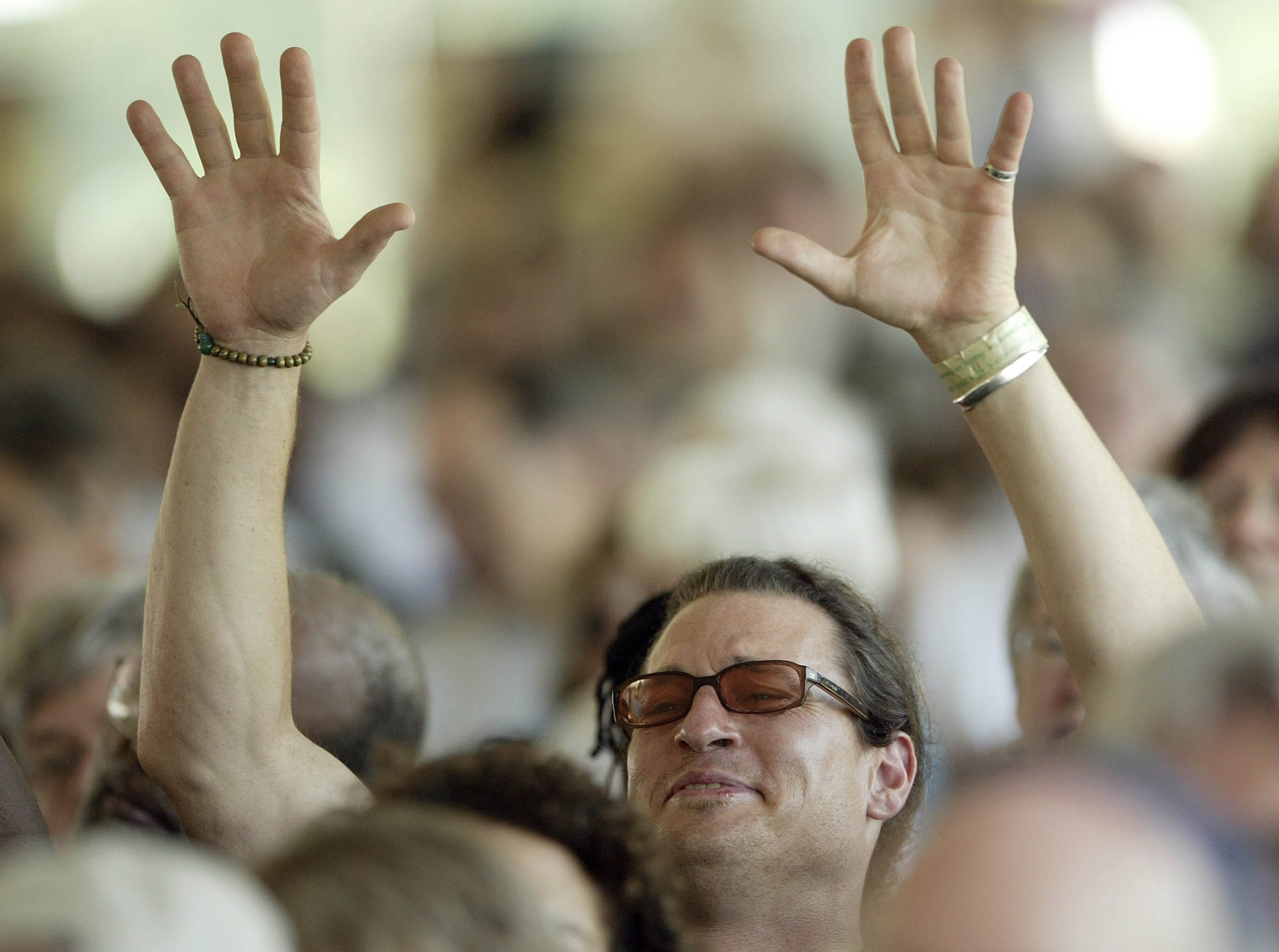 Stephen Meyers from Berkley, Calif., raises his hands in praise during a gathering to mark the 75th Anniversary of the Highlander Center Saturday, Sept. 1, 2007 in New Market, Tenn.  The little school tucked away in the east Tennessee mountains may have faded from the public spotlight, but it was once at the center of the struggle for civil rights.