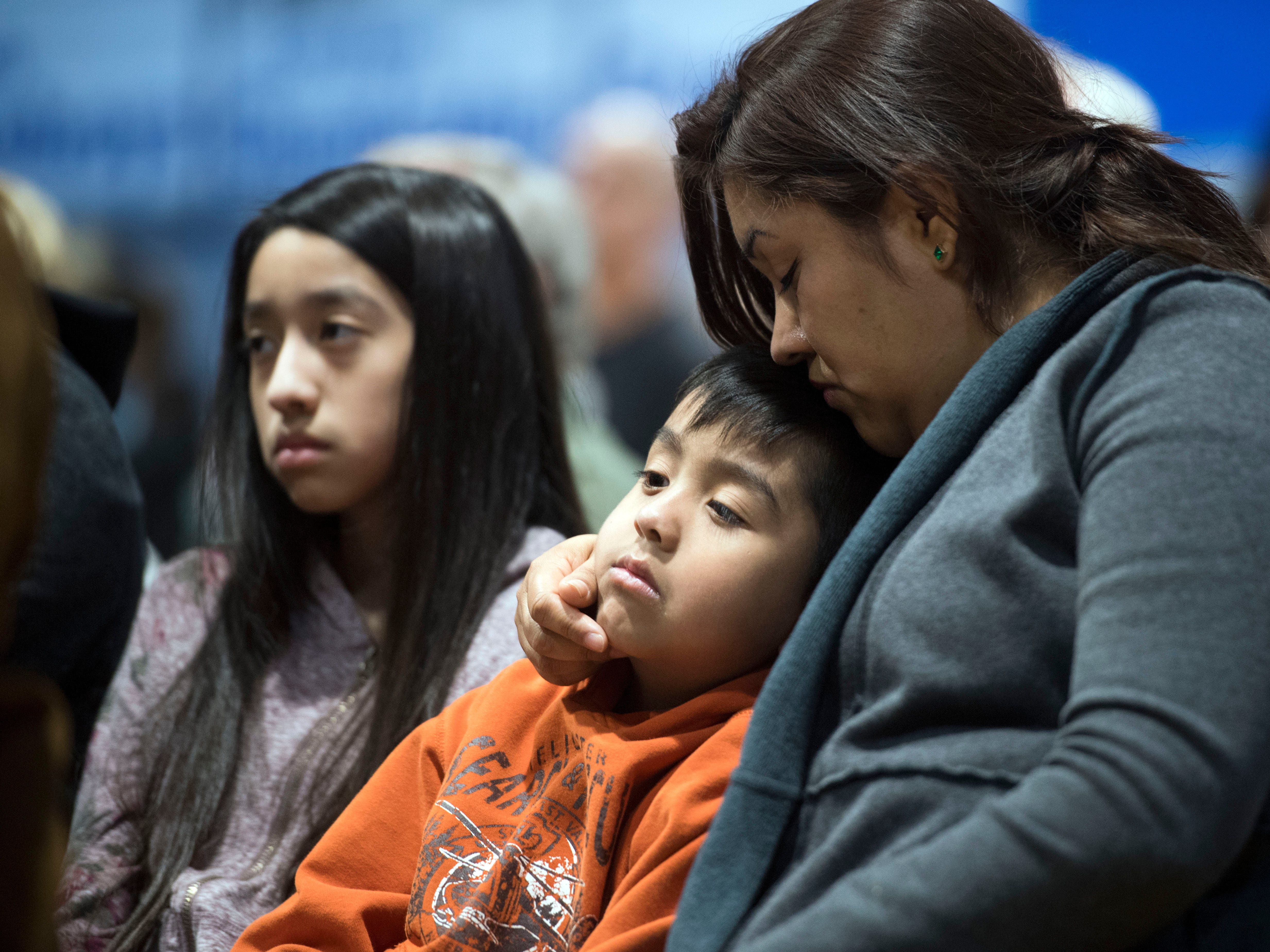 A family attends a prayer vigil hosted by Tennessee Immigrant and Refugee Rights Coalition and the Highlander Center on Monday, April 9, 2018 at Hillcrest Elementary School in Morristown, TN in response the detainment of immigrant workers after ICE raided Southeastern Provisions, a cattle slaughterhouse in Grainger County.