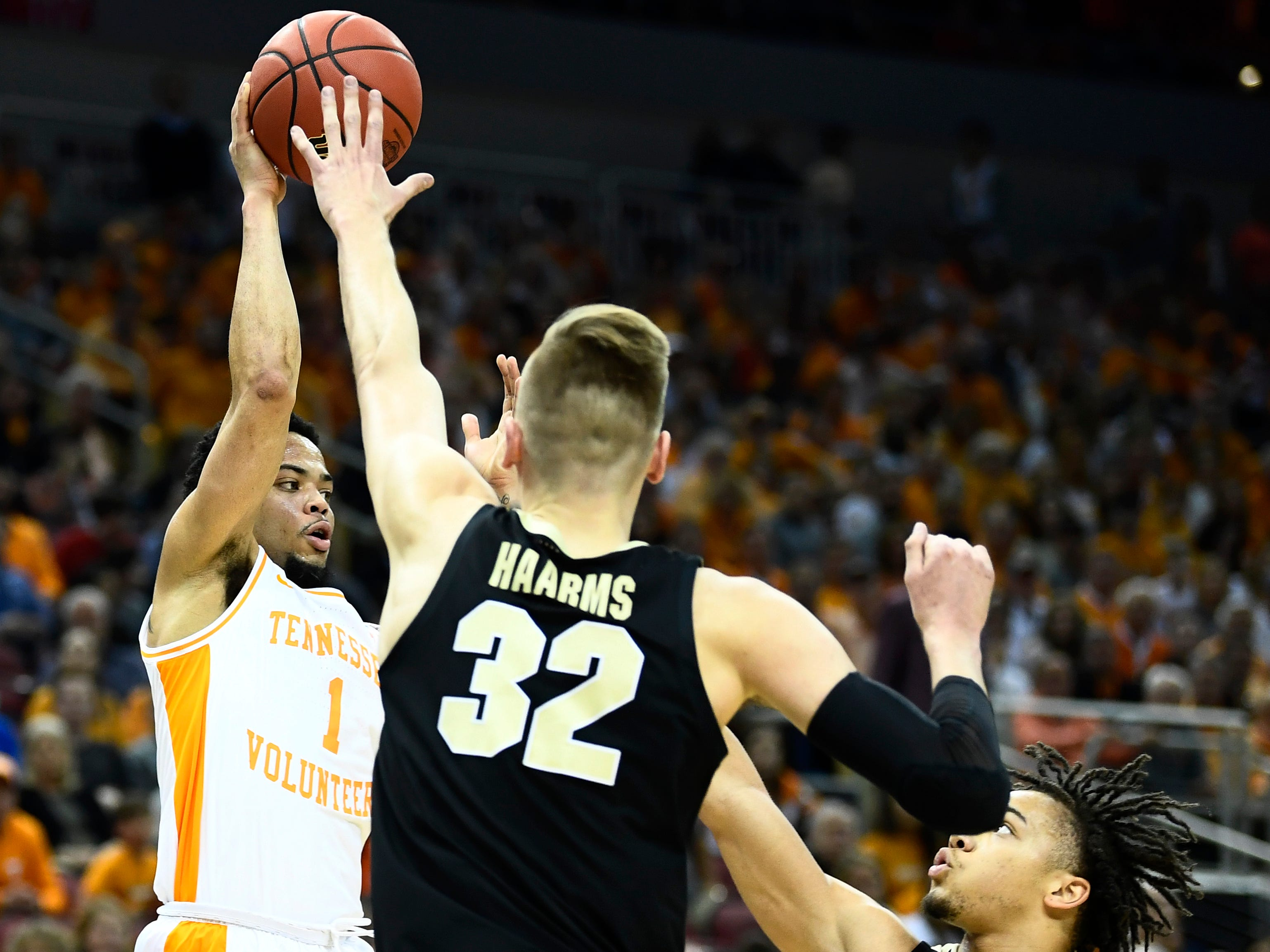 Tennessee guard Lamonte Turner (1) tries to pass defended by Purdue center Matt Haarms (32) and Purdue guard Carsen Edwards (3) during the first half of their Sweet 16 game in the NCAA Tournament Thursday, March 28, 2019, at the KFC Yum! Center in Louisville, Ky.