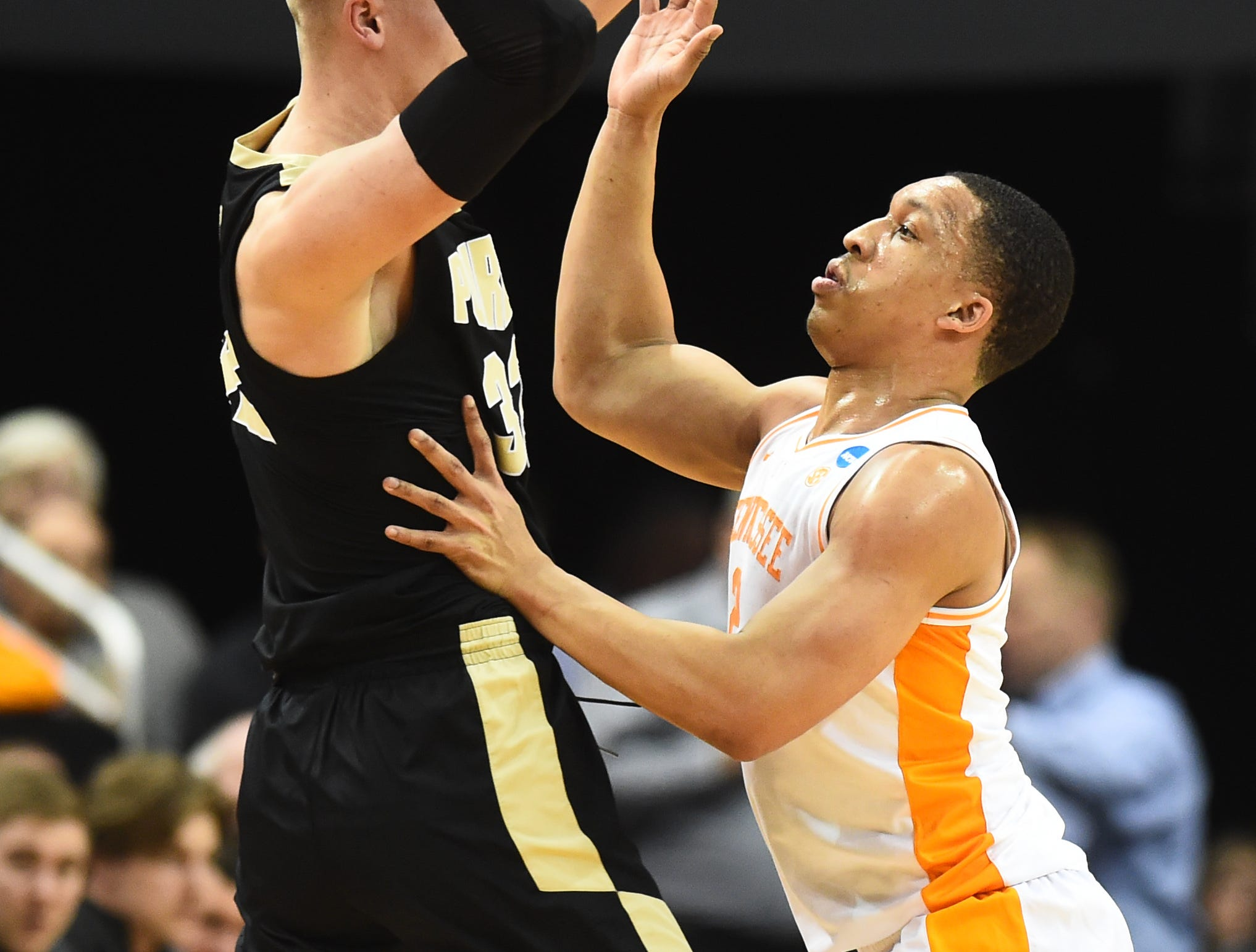 Tennessee forward Grant Williams (2) defends as Purdue center Matt Haarms (32) tries to move the ball during the first half of their Sweet 16 game in the NCAA Tournament Thursday, March 28, 2019, at the KFC Yum! Center in Louisville, Ky.