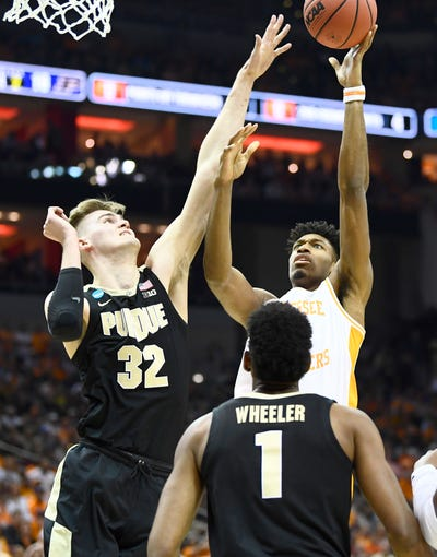 Tennessee forward Kyle Alexander (11) shoots defended by Purdue center Matt Haarms (32) and Purdue forward Aaron Wheeler (1) during the first half of their Sweet 16 game in the NCAA Tournament Thursday, March 28, 2019, at the KFC Yum! Center in Louisville, Ky.