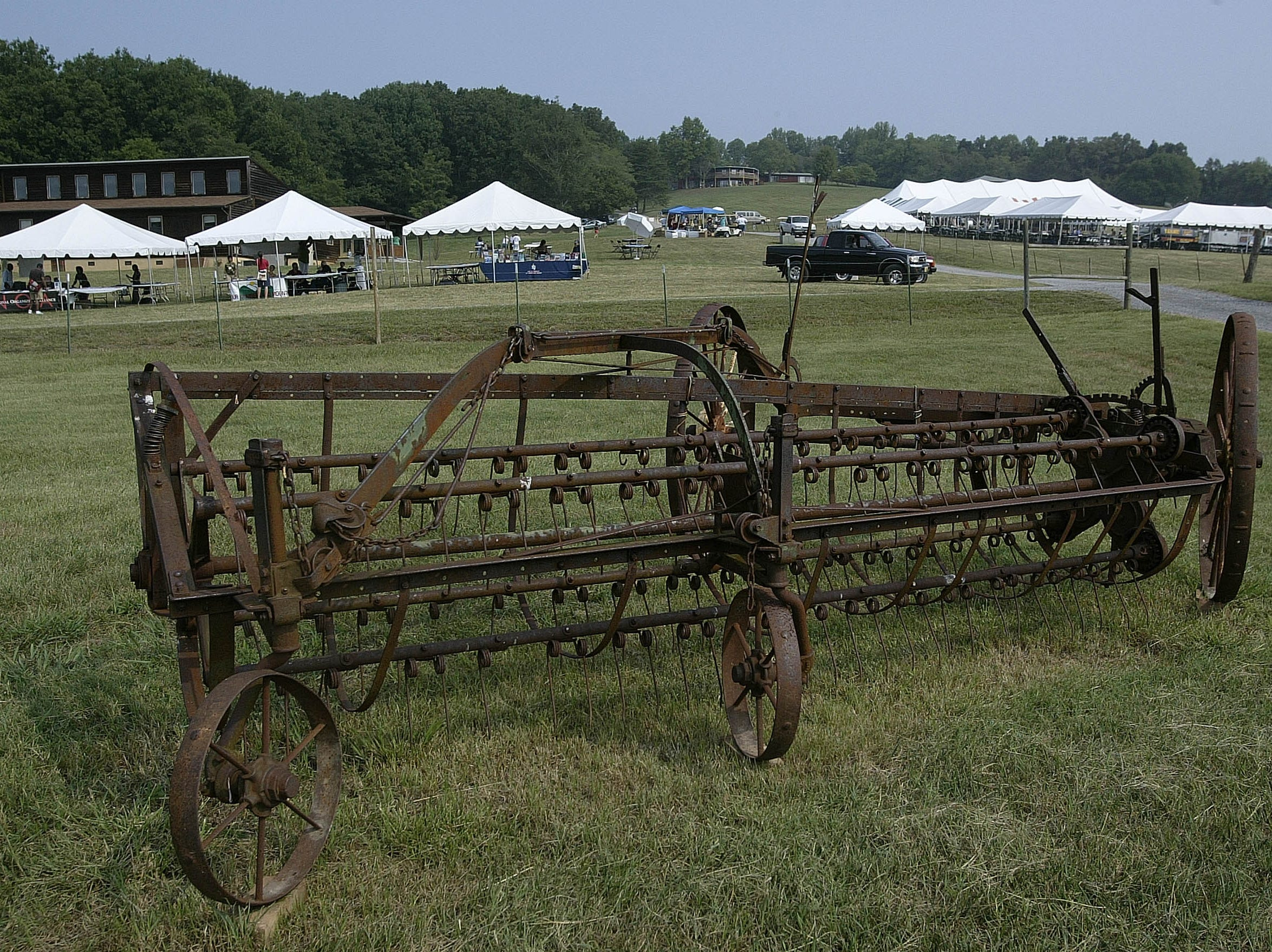 An antique piece of farm equipment sits near tents where participants sing and attend workshops during a gathering held  to mark the  anniversary of the Highlander Research and Education Center, Sept. 1, 2007 in New Market, Tenn.  It has been investigated by the House Committee on Un-American Activities, spied on by a governor of Georgia and marched on by the Klan, but the Highlander Research and Education Center has stuck around.