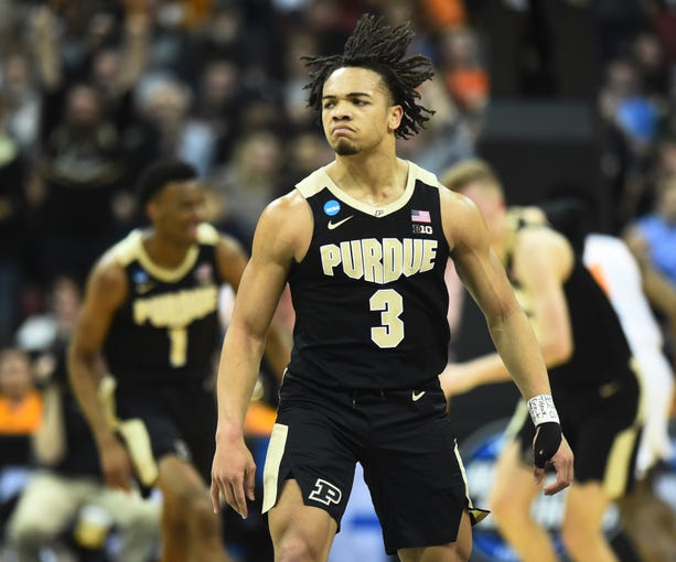 Purdue guard Carsen Edwards (3) reacts during the first half of their game against Tennessee in the NCAA Tournament Thursday, March 28, 2019, at the KFC Yum! Center in Louisville, Ky.