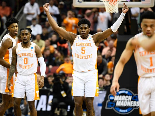 Tennessee guard Admiral Schofield (5) gestures to the Tennessee fans to get louder during the Tennessee VolunteersÕ basketball Sweet 16 game against the Purdue Boilermakers in the NCAA Tournament held at the KFC Yum! Center in Louisville, Ky., on Thursday, March 28, 2019.