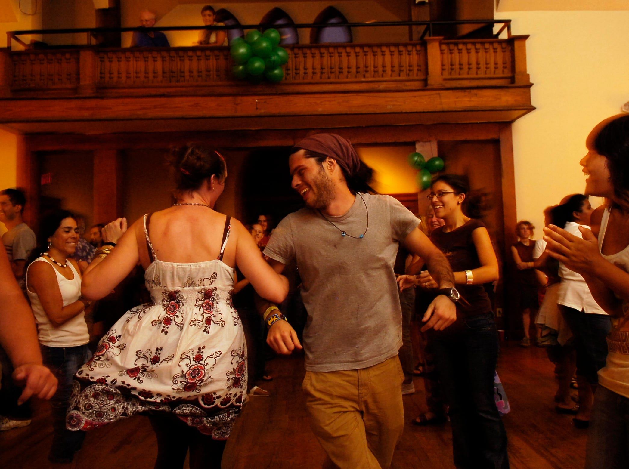 Ashley Sparks from Staunton, VA, and Alfonso Diaz from Mexico whirl to a contradanse tune during the Highlander Center for Research and Education's 75th anniversary celebration on Friday at the Laurel Theater.