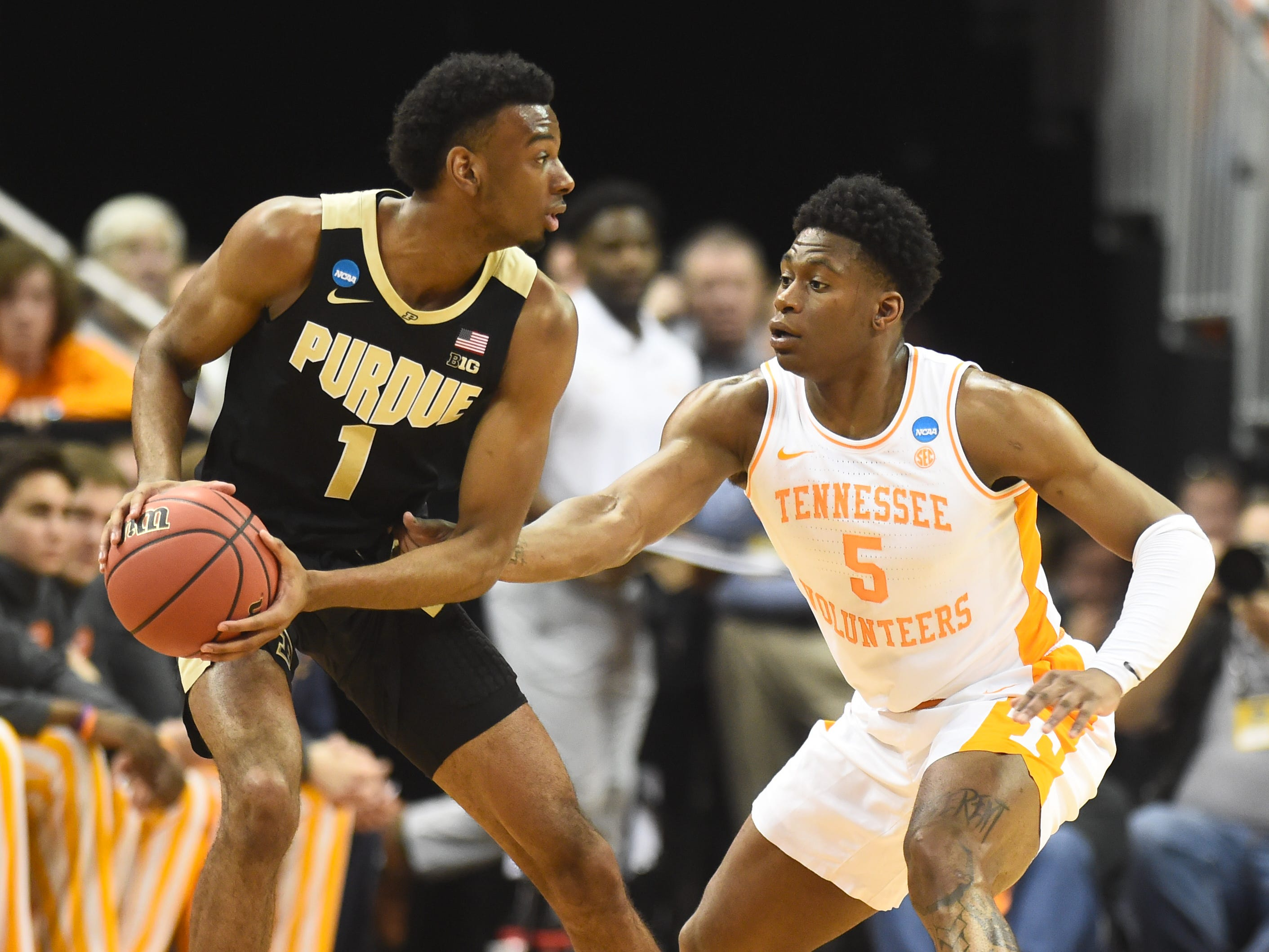 Tennessee guard Admiral Schofield (5) defends as Purdue forward Aaron Wheeler (1) tries to move the ball during the first half of the Sweet 16 game in the NCAA Tournament Thursday, March 28, 2019, at the KFC Yum! Center in Louisville, Ky.