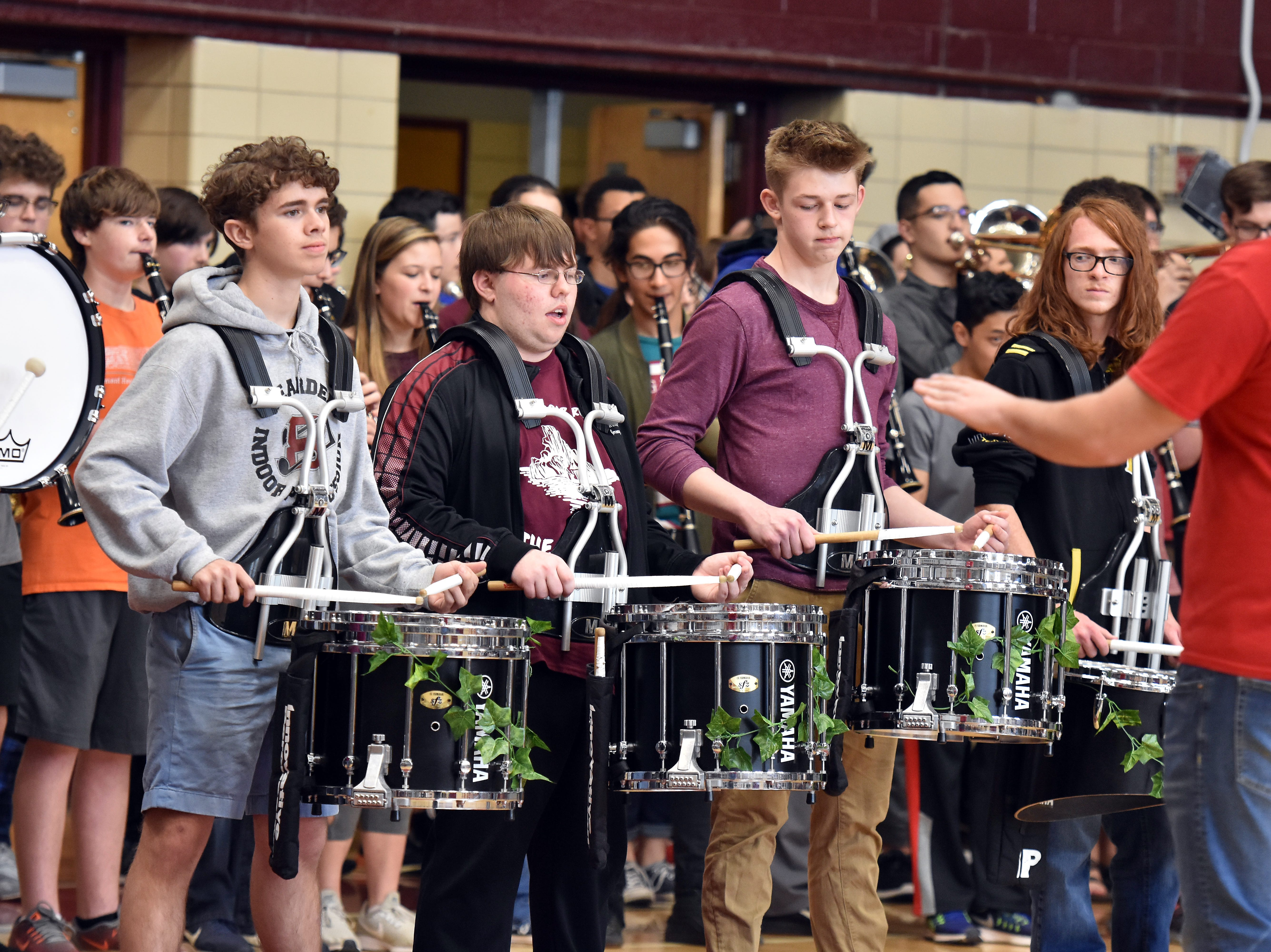 Bearden High band members play the school fight song during the pep rally to honor the state championship basketball team on Friday, March 29.