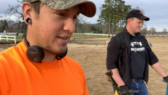 """Matt Ryan and Jon Russell, """"The Equinox Hunter,"""" hunt for treasure at the Cove at Concord Park Tuesday, March 12."""