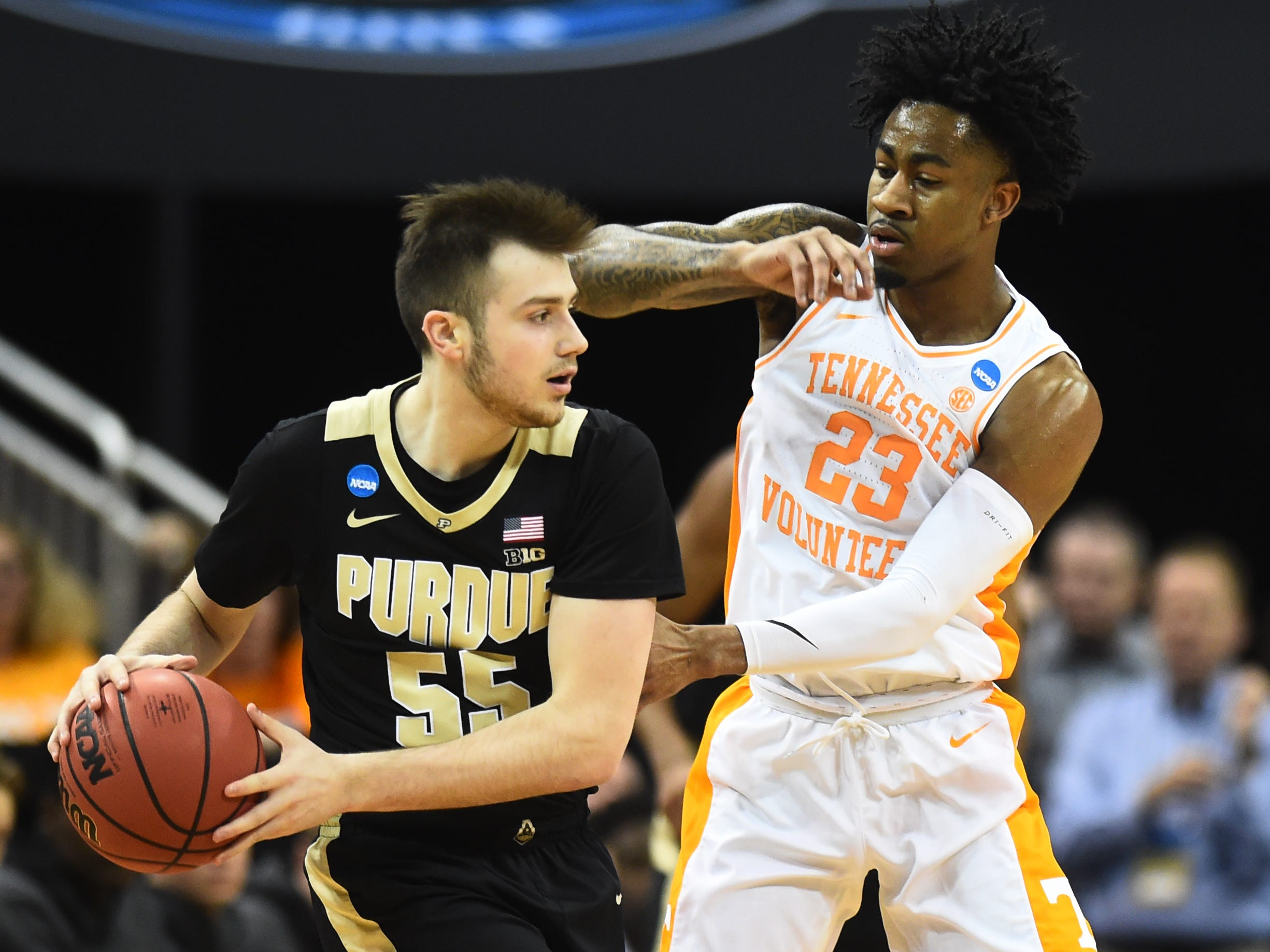 Purdue guard Sasha Stefanovic (55) tries to move the ball defended by Tennessee guard Jordan Bowden (23) in the first half of their Sweet 16 game in the NCAA Tournament Thursday, March 28, 2019, at the KFC Yum! Center in Louisville, Ky.