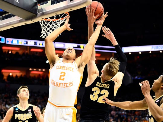 Tennessee forward Grant Williams (2) and Purdue center Matt Haarms (32) go up for the rebound during the Tennessee VolunteersÕ basketball Sweet 16 game against the Purdue Boilermakers in the NCAA Tournament held at the KFC Yum! Center in Louisville, Ky., on Thursday, March 28, 2019.