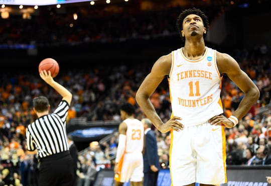 Tennessee forward Kyle Alexander (11) reacts in the closing minutes of the team's overtime loss in the Sweet 16 to  the Purdue Boilermakers in the NCAA Tournament Thursday, March 28, 2019, at the KFC Yum! Center in Louisville, Ky.