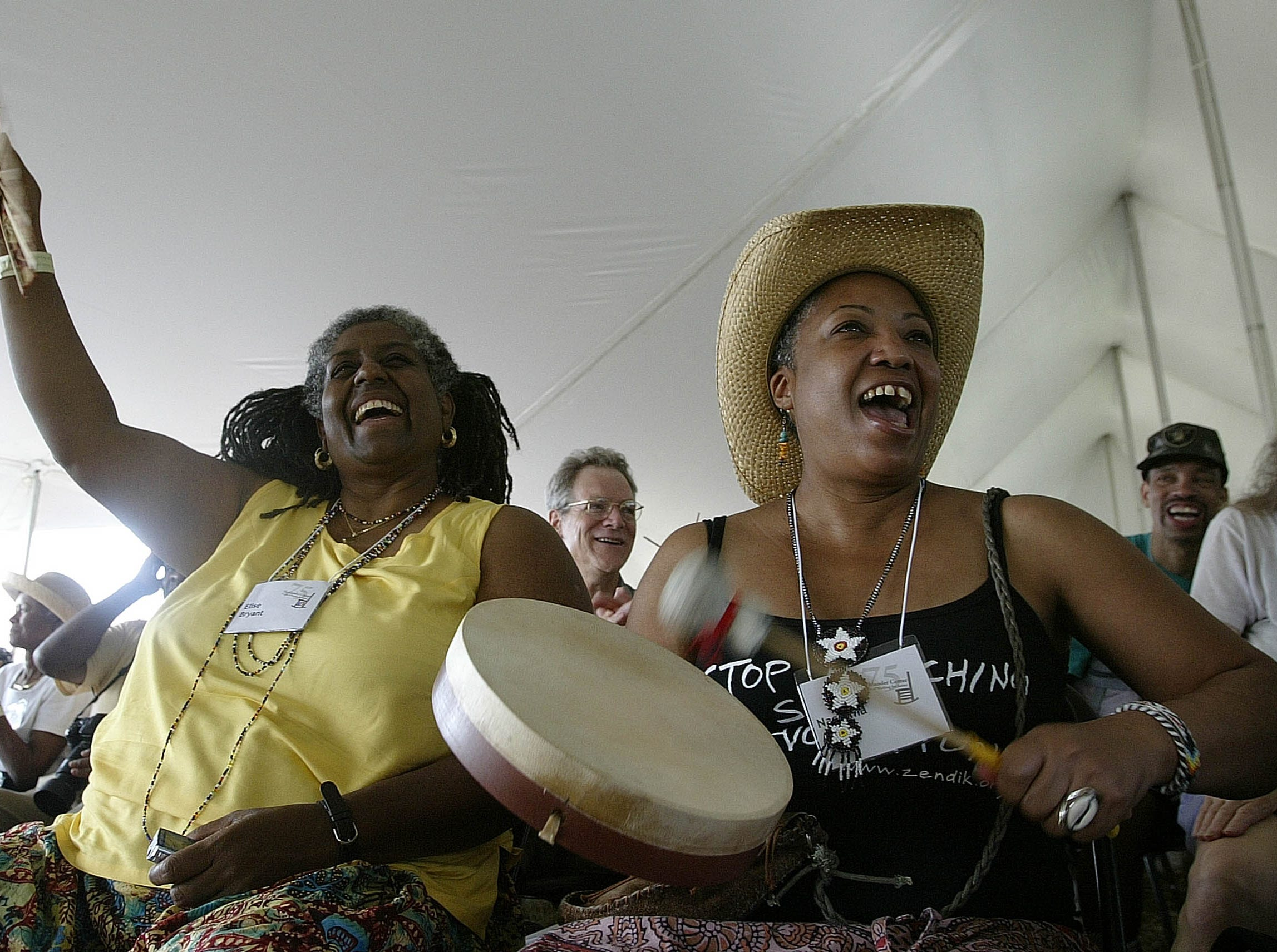 Elise Bryant, left, and Naazima Ali celebrate during a   gathering held to mark the  anniversary of the Highlander Research and Education Center, Sept. 1, 2007 in New Market, Tenn.  It has been investigated by the House Committee on Un-American Activities, spied on by a governor of Georgia and marched on by the Klan, but the Highlander Research and Education Center has stuck around.