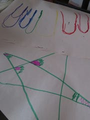Some of paper decorated by Torrie Dreier's children and used in packaging of candles produced by 865 Candle Company.