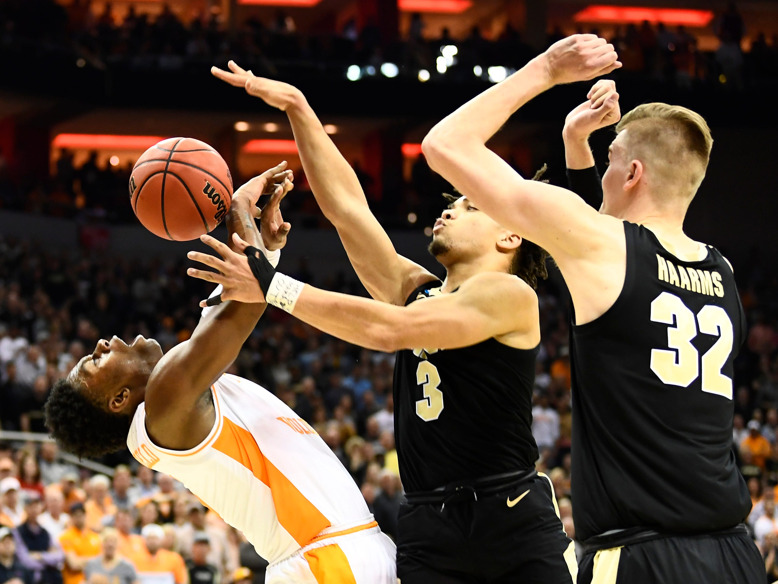 Purdue guard Carsen Edwards (3) fouls Tennessee guard Admiral Schofield (5) in their Sweet 16 game in the NCAA Tournament Thursday, March 28, 2019, at the KFC Yum! Center in Louisville, Ky.