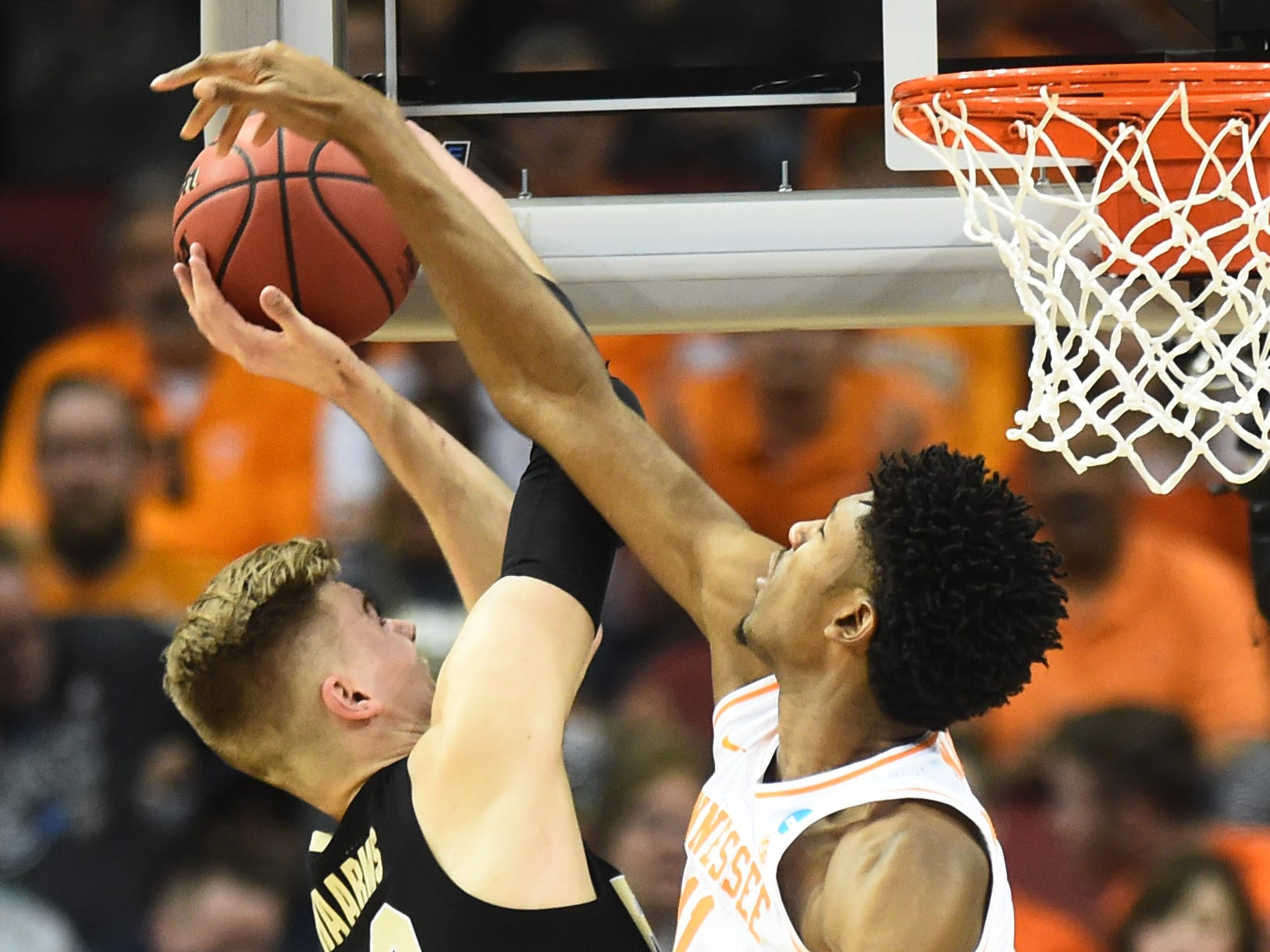 Tennessee forward Kyle Alexander (11) defends as Purdue center Matt Haarms (32) goes to the baske during their Sweet 16 game in the NCAA Tournament Thursday, March 28, 2019, at the KFC Yum! Center in Louisville, Ky.