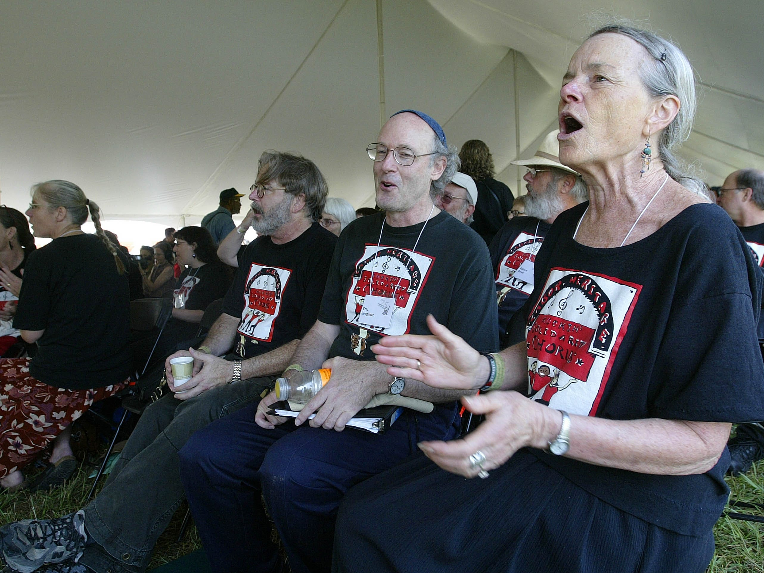 Mary Izett, right, Eric Bergman, center, and Doug Norman of Lafayette, Calif., sing during a gathering to mark the 75th Anniversary of the Highlander Research and Education Center Saturday, Sept. 1, 2007, in New Market, Tenn. The little school tucked away in the east Tennessee mountains may have faded from the public spotlight, but it was once at the center of the struggle for civil rights.