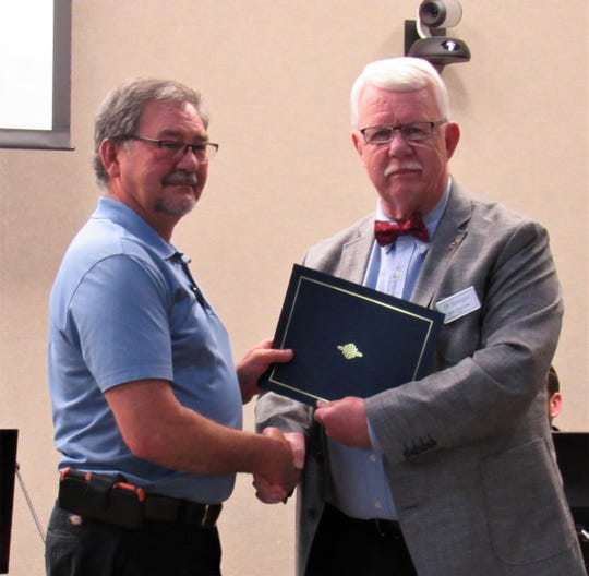 John Householder received a proclamation from Mayor Ron Williams at the board meeting on March 28.  After 23 years in code enforcement and as a commercial plans examiner, Householder is retiring on April 11; the day will be named in recognition of his service.